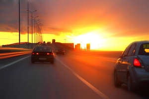 cars at sunset on the highway in traffic